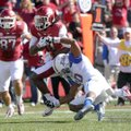 Cobi Hamilton, University of Arkansas receiver, is taken down at the one-yard line to set up an Arka...