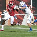 NWA Media/ MICHAEL WOODS - Arkansas receiver Cobi Hamilton tries to fend off Tulsa defender Mitchell...