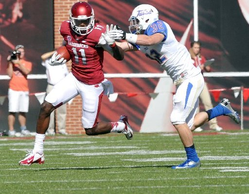 NWA Media/ MICHAEL WOODS - Arkansas receiver Cobi Hamilton tries to fend off Tulsa defender Mitchell Osborne as he runs for a big gain in the third quarter of a Nov. 3, 2012 game at Donald W. Reynolds Razorback Stadium.