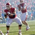 Arkansas quarterback Tyler Wilson (8) completed 21 of 31 passes for 272 yards in Saturday's 19-15 vi...