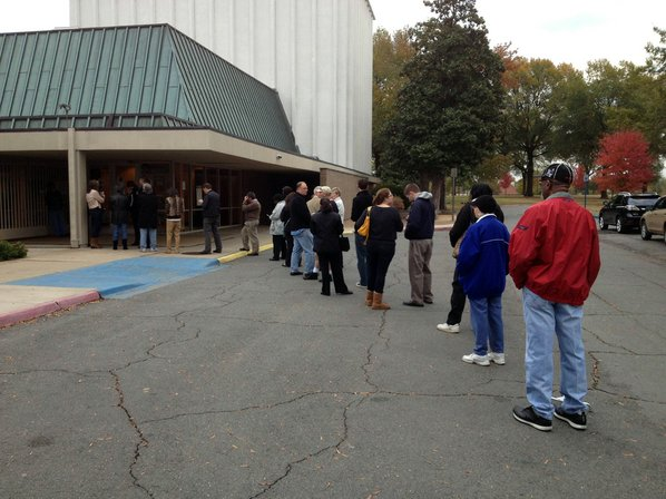 Voters line up Tuesday, Nov. ...