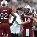 South Carolina coach Steve Spurrier talks to quarterback Connor Shaw asD. L. Moore looks on during t...