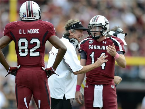 South Carolina coach Steve Spurrier talks to quarterback Connor Shaw asD. L. Moore looks on during the first half of an NCAA college football game against Tennessee, Saturday, Oct. 27, 2012, at Williams-Brice Stadium in Columbia, S.C.(AP Photo/Richard Shiro)