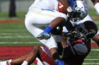 Arkansas' Demetrius Wilson (right) pulls down Tulsa's Trey Watts during Arkansas' 19-15 victory Saturday. Watts rushed for 81 yards and had 2 catches for 53 yards.