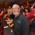 Fayetteville Mayor Lioneld Jordan looks up at the TV to see the latest results Tuesday evening as su...