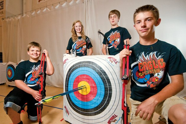 from-the-left-jack-allen-gina-mishark-jack-looney-and-ronnie-jeffery-are-members-of-the-eagle-mountain-magnet-school-archery-team