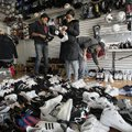A shopper (center) picks through water-damaged shoes Tuesday in Sneaker Town in the Coney Island sec...