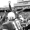 FILE - This Jan. 1, 1973 file photo shows Texas coach Darrell Royal being carried off the field by h...