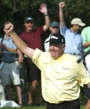 Billy Mayfair, of Scottsdale, Ariz., reacts after making an eagle on the par-five 17th hole during first round of the International Golf Tournament in Castle Rock, Colo., on Friday, August 5, 2005. (AP Photo/Rob Stuehrk)