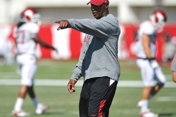 University of Arkansas coach Paul Haynes works with the defense during practice Tuesday afternoon in Fayetteville.