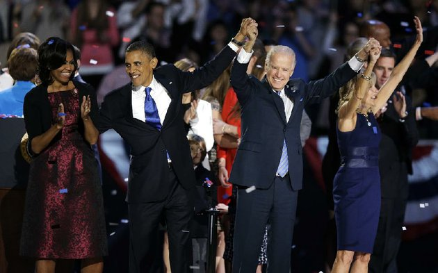 president-barack-obama-first-lady-michelle-obama-vice-president-joe-biden-and-jill-biden-acknowledge-the-crowd-at-his-election-night-party-wednesday-nov-7-2012-in-chicago-president-obama-defeated-republican-challenger-former-massachusetts-gov-mitt-romney-ap-photochris-carlson