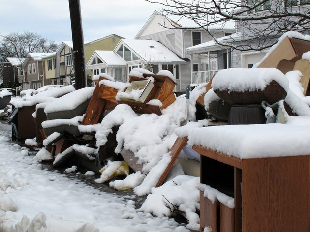 four-inches-of-snow-covers-piles-of-debris-from-superstorm-sandy-in-point-pleasant-beach-nj-on-thursday-nov-8-2012-a-day-after-a-noreaster-hit-the-storm-weary-state-emergency-dunes-seemed-to-have-held-during-the-recent-storm-and-flooding-that-had-been-feared-did-not-materialize