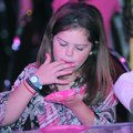 Taylor Roberts, 8, savors every last bite of frosting Wednesday from her cupcake during the Northwes...