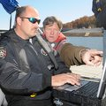 John De Mille, right, marketing, sales and operations director for Marine Sonic Technology, teaches ...