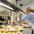 Annette Stanfill (above) of the First United Methodist Church serves a meal Wednesday for the church...