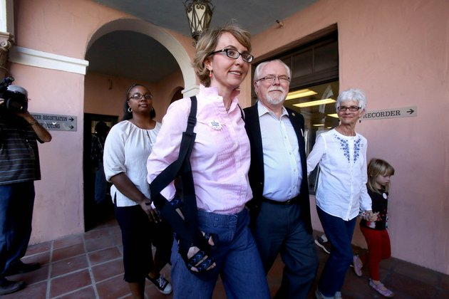 former-rep-gabrielle-giffords-and-rep-ron-barber-d-ariz-democratic-candidate-for-congress-arizona-district-2-leave-the-the-pima-county-recorders-office-in-tucson-ariz-after-turning-in-their-early-ballots-monday-nov-5-2012