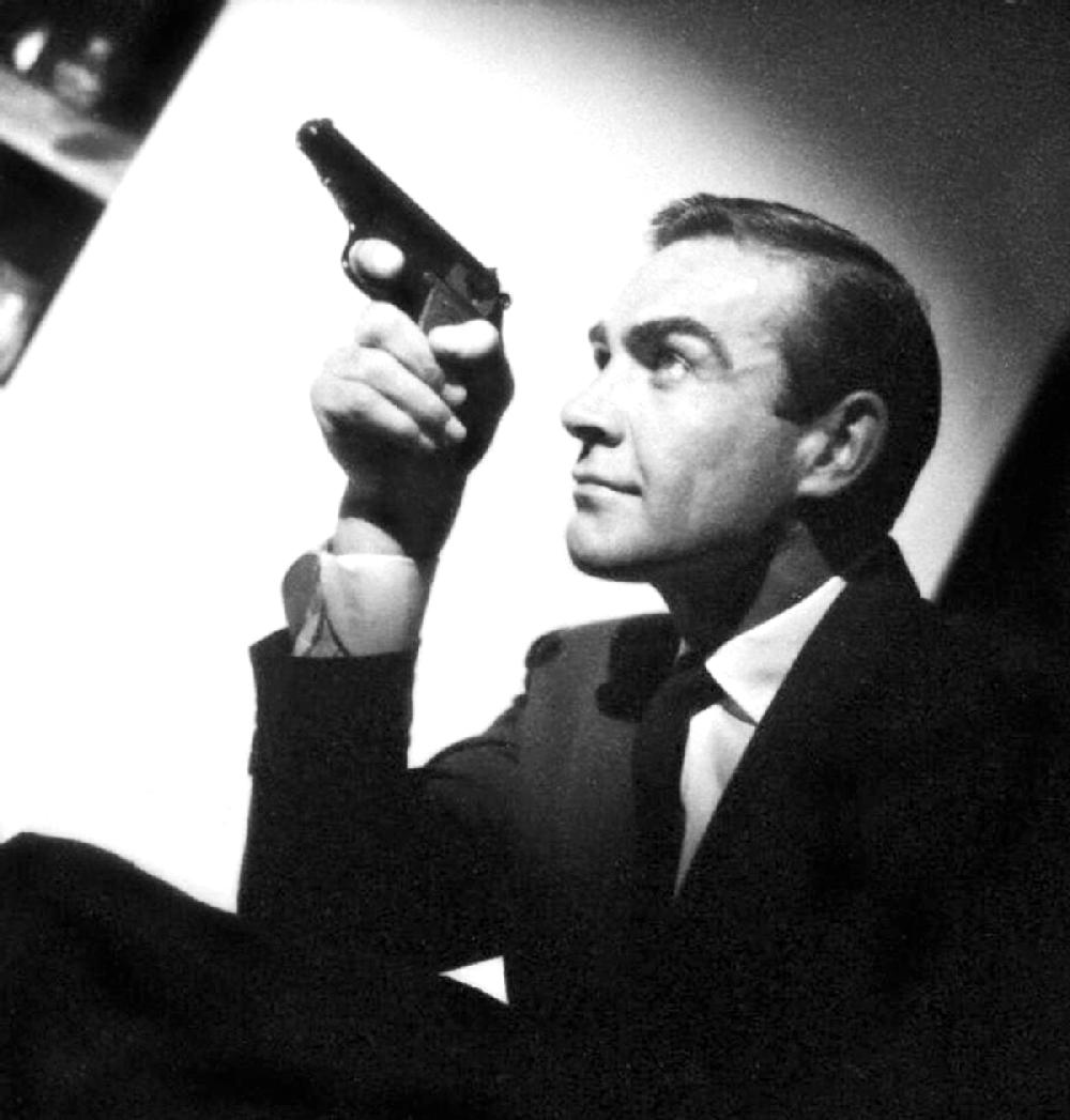 sean connery as secret agent james bond holds a walther