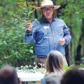 Cody George, Crystal Bridges field horticulturist, speaks about the local plants to those in attenda...