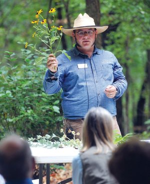 "Cody George, Crystal Bridges field horticulturist, speaks about the local plants to those in attendance for the program ""Discover the Grounds: Preserving the Freshwater Ecosystem at Crystal Bridges."" The museum hosts many such events on the surrounding grounds."