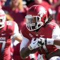 Arkansas wide receiver Cobi Hamilton (left) already has caught a school-record 69 passes this season...