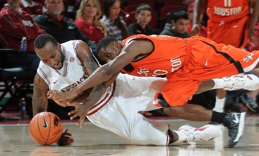 NWA MEDIA/SAMANTHA BAKER -- Arkansas' Marshawn Powell (left) and Jeremy McKay from Sam Houston State dive for the ball during the second half of the men's season opener Friday, Nov. 9, 2012, at Bud Walton Arena in Fayetteville.