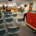Sharon Rose with the Benton County Election Commission pulls a cart Thursday of Benton County paper ...