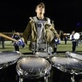 Nathan Aronowitz, 17, Rogers High senior, plays the Mountie fight song on the tenor drums Oct. 26 be...