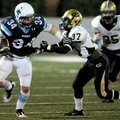 Springdale Har-Ber senior running back Tucker Lee (34) stiff arms Little Rock Central junior Nate Mc...