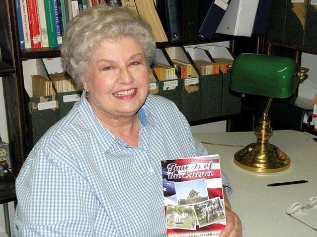 vivian-lawson-hogue-editor-of-faulkner-facts-and-fiddlings-holds-a-copy-of-a-special-edition-of-the-journal-time-is-of-the-essence-which-is-on-sale-at-the-faulkner-county-museum-and-the-faulkner-county-library-in-conway-the-edition-is-dedicated-to-veterans-and-features-war-stories-told-by-veterans-or-their-family-members