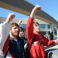 Branden Uhrig, (above) left, and Tonsend Wenzler sing a school song during a pep rally Thursday at R...