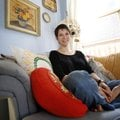 Vanessa Ryerse sits in her favorite personal space, the corner of her bedroom in her Springdale home...