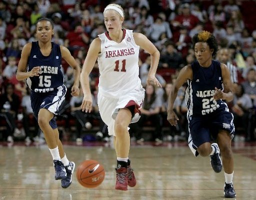 NWA Media/DAVID GOTTSCHALK -- Arkansas' Calli Berna brings the ball down court in front of Jackson State's Demara Howard (15) and Marchetta Parker (23) Friday afternoon at Bud Walton Arena in Fayetteville. Berna scored a career-high 22 points in the 97-58 win.