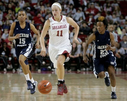 nwa-mediadavid-gottschalk-arkansas-calli-berna-brings-the-ball-down-court-in-front-of-jackson-states-demara-howard-15-and-marchetta-parker-23-friday-afternoon-at-bud-walton-arena-in-fayetteville-berna-scored-a-career-high-22-points-in-the-97-58-win
