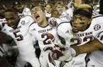 Texas A&M quarterback Johnny Manziel (2) is joined by wide receiver Kenric McNeal (5) and defensive back Dustin Harris (22) as they celebrate a win over top-ranked Alabama at Bryant-Denny Stadium in Tuscaloosa, Ala., Saturday, Nov. 10, 2012. This year's game is at the top of a list for most expensive tickets for the 2013 college football season that U.S. Presswire released. (AP Photo/Dave Martin)