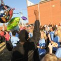 Southwest Junior High School students release balloons Friday in honor of Cameron Wickham, an eighth...