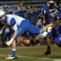 Jacob Harris, left, Rogers receiver, watches on Friday as Conway's A.J. Burton tries to haul in a de...