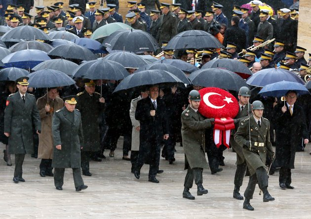 turkish-president-abdullah-gul-center-ministers-and-army-commanders-follow-a-guard-of-honour-at-the-mausoleum-of-turkeys-founder-kemal-ataturk-during-a-ceremony-marking-the-74th-anniversary-of-his-death-in-ankara-turkey-saturday-nov-10-2012-turkish-media-say-17-soldiers-have-been-killed-in-a-helicopter-crash-early-saturday-in-siirt-province-in-the-countrys-southeast-state-run-trt-television-said-the-crash-occurred-in-heavy-fog-in-a-mountainous-area