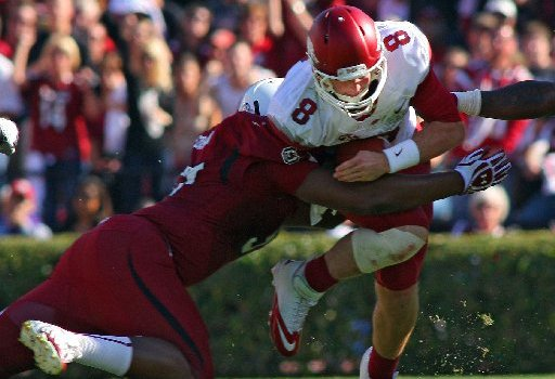 Arkansas Democrat-Gazette/STEPHEN B. THORNTON -- South Carolina's Aldrick Fordham sacks Arkansas QB Tyler Wilson in the second quarter during their game Saturday afternoon in South Carolina.
