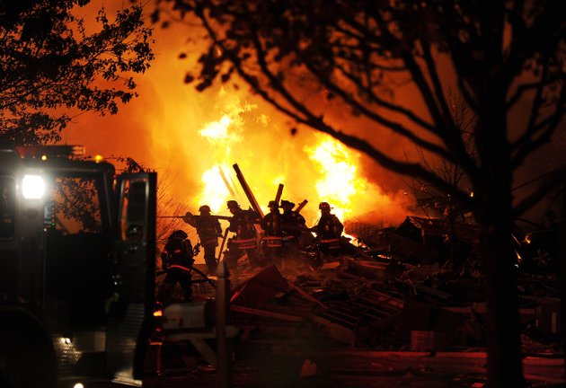 firefighters-work-the-scene-where-an-explosion-has-killed-two-people-and-damaged-more-than-a-dozen-homes-in-the-richmond-hill-subdivision-late-saturday-nov-10-2012-in-indianapolis