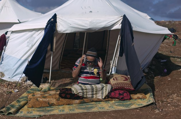 a-syrian-elderly-disabled-man-who-fled-from-the-violence-in-his-village-prays-in-front-of-his-tent-at-a-displaced-camp-in-the-syrian-village-of-atma-near-the-turkish-border-with-syria-saturday-nov-10-2012