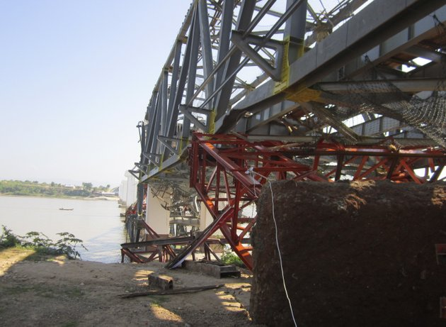 structures-of-a-bridge-under-construction-across-the-irrawaddy-river-east-of-shwebo-myanmar-are-seen-damaged-after-a-strong-earthquake-on-sunday-nov-11-2012-the-magnitude-68-quake-struck-northern-myanmar-on-sunday-collapsing-the-bridge-and-a-gold-mine-damaging-several-old-buddhist-pagodas-and-leaving-as-many-as-12-people-feared-dead-the-bridge-links-the-town-of-sintku-40-miles-north-of-mandalay-on-the-east-bank-of-the-irrwaddy-with-kyaukmyaung-on-the-west-bank