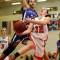 Brittany Ward, Rogers Heritage, takes the ball to the basket under pressure from Fayetteville's Vane...