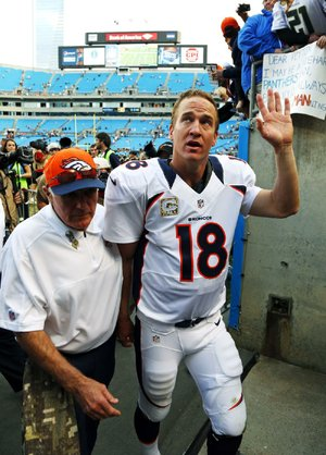 Denver Broncos quarterback Peyton Manning waves to fans after Sunday's game against the Carolina Panthers in Charlotte, N.C.