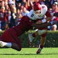 Arkansas football Coach John L. Smith says senior quarterback Tyler Wilson has earned the right to s...
