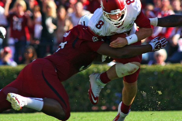 Arkansas football Coach John L. Smith says senior quarterback Tyler Wilson has earned the right to stay in games as long as he wants.