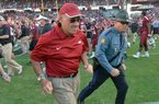 NWA Media/ MICHAEL WOODS --11/10/2012-- John L Smith runs off the field following Arkansas' 38-20 loss to South Carolina on Saturday at Williams-Brice Stadium.