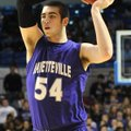 Tyler McCullough, Fayetteville, looks for an open teammate March 9 at Summit Arena in Hot Springs du...