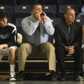 Adam Simmons, center, Springdale Har-Ber coach, calls out instructions to his team Feb. 24 at Wildca...