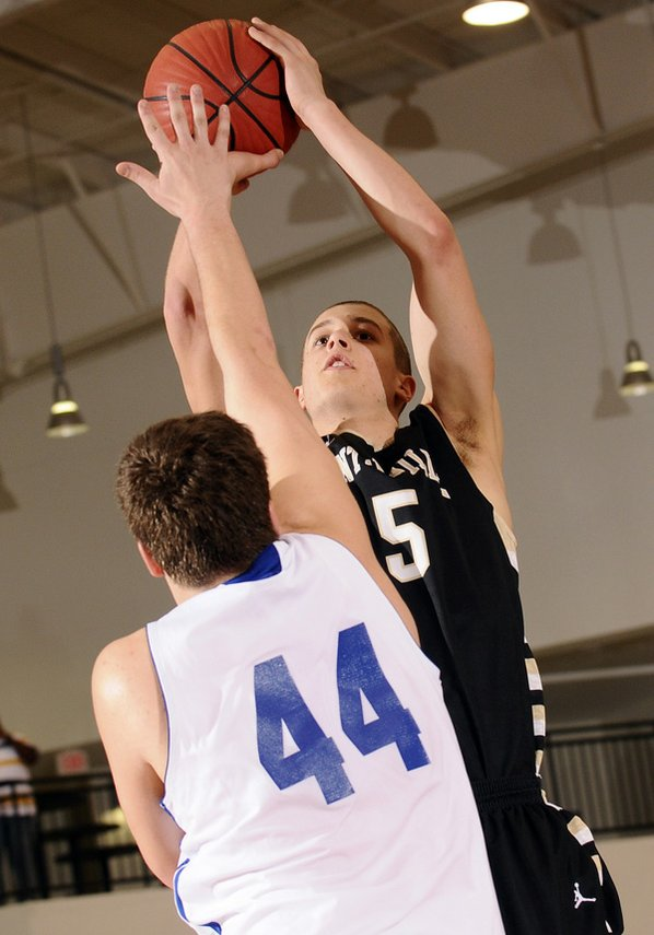 Nick Smith, Bentonville, shoots over ...