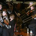 Members of the Ozark Mountains British Brass Band perform on stage in the auditorium on Sunday insid...